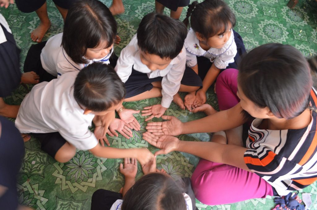 children playing with volunteer