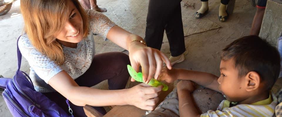 volunteer plays with child