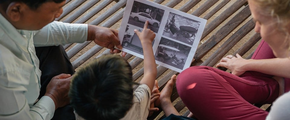 child pointing at image