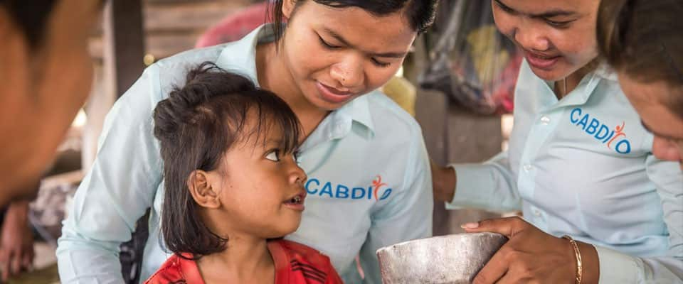 girl with CABDICO volunteers