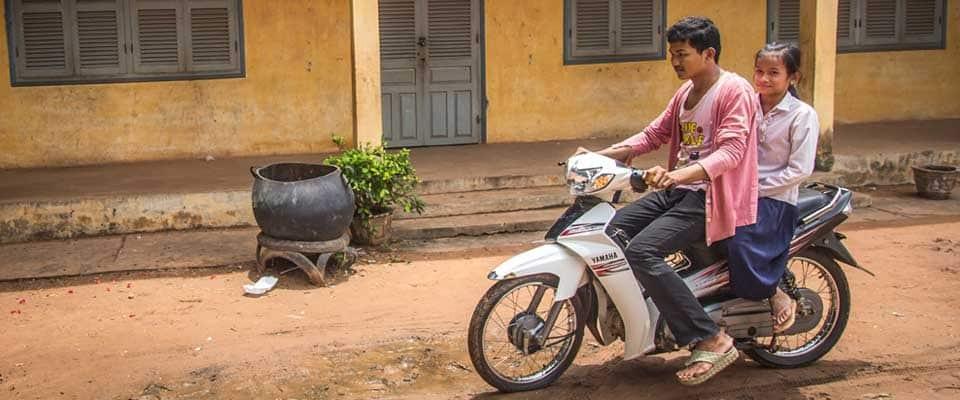 man with girl riding motorbike