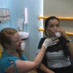 volunteer helping a patient with swallowing difficulty